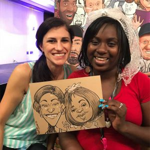 Holiday party guests show off their caricature art.