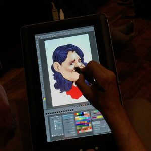 Artist draws caricature on a tablet using eSketch