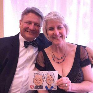 couple enjoying wedding caricature