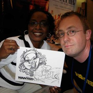 happy trade show guests with caricature
