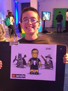 Young Boy at Lego Event Holding a caricature