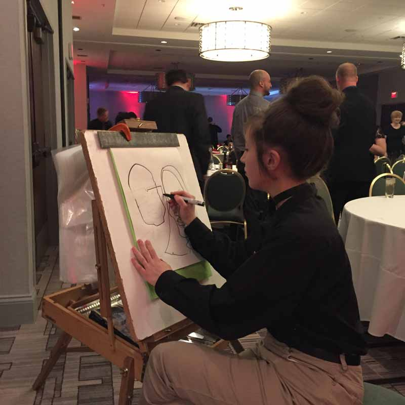 caricature artist drawing two people