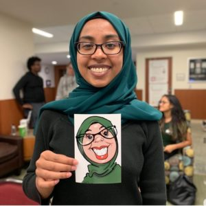 Student with colorful eSketch caricature art at MSU.
