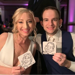 New bride and groom show their Goofy Faces caricature coasters.