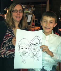 Happy woman and son show their caricature art.