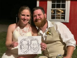 Happy couple shows off their wedding caricature.