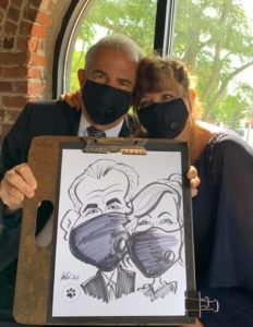 Wedding caricature of couple with masks
