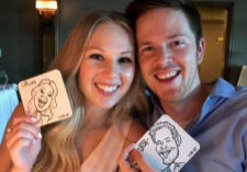 Couple shows off their Goofy Faces caricature coasters.